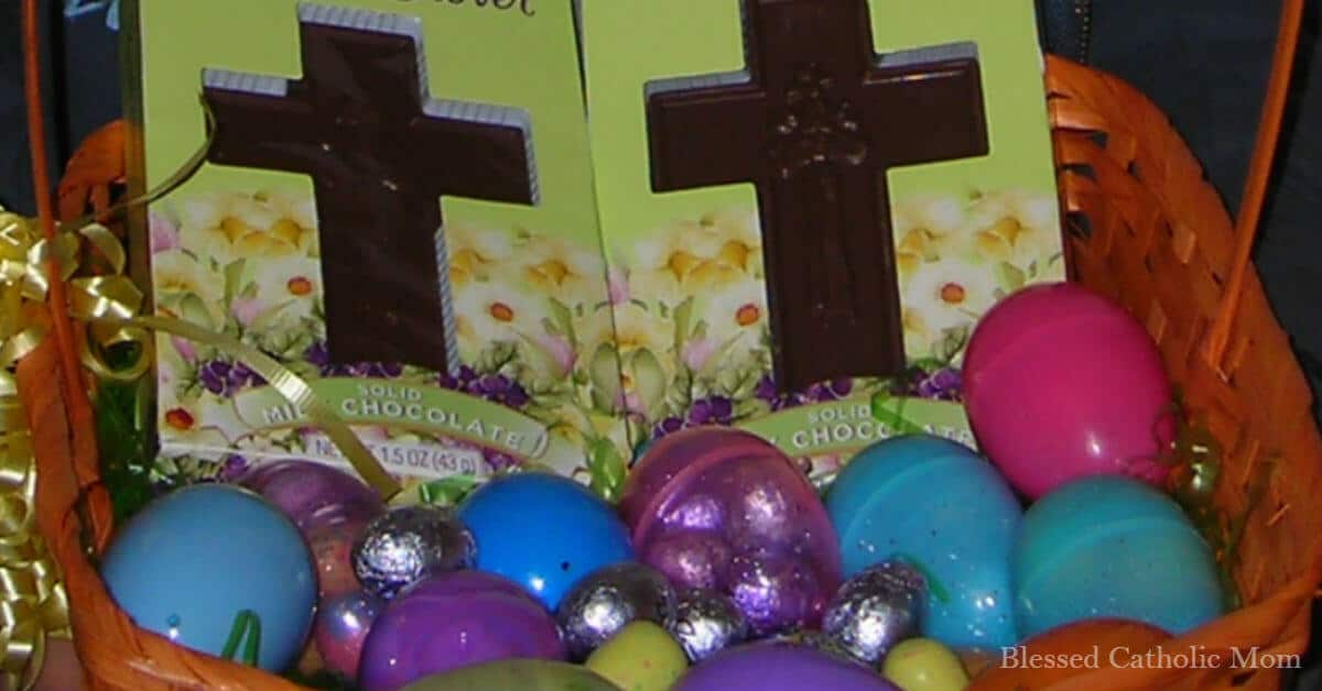Easter is not about chocolate but about growing closer to Jesus. Image of an Easter basket filled with candy, chocolate crosses, and plastic eggs.
