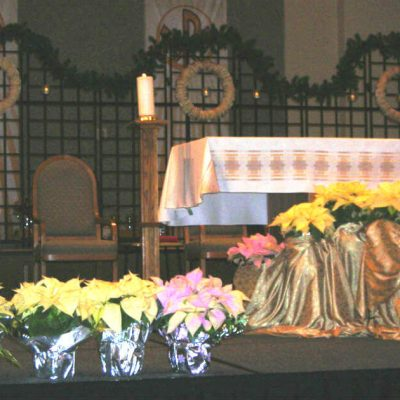 Tips for Going To Mass with Young Children, image: decorated altar in a Catholic Church
