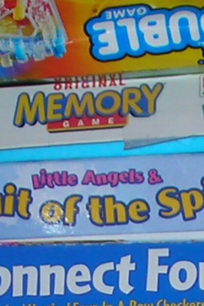 Schedule family date nights to have fun and build relationships. Image of a stack of board games.