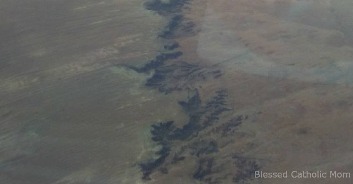 Image is an aerial photo of the Grand Canyon.