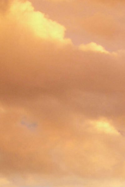 Image of orangish, cloudy evening sky at sunset.