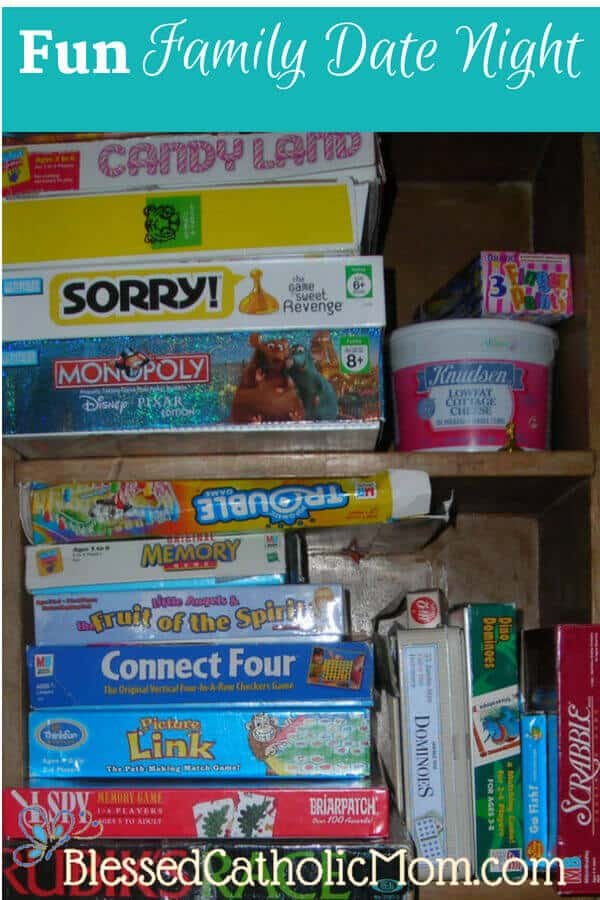 "Image of a bookshelf filled with games. Title ""Fun Family Date Night"" on top. Blessed Catholic Mom logo on bottom."