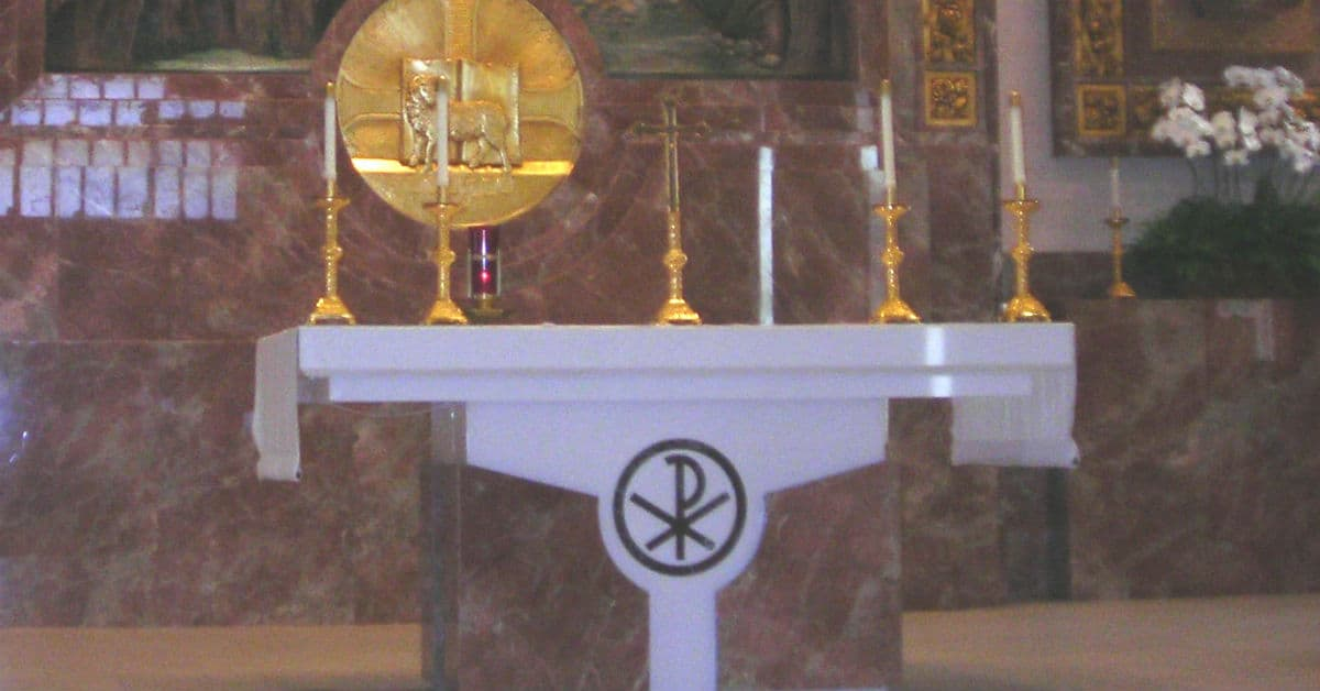 Pray at Mass for an intention. Image of an altar at a Catholic church.