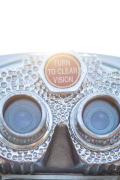 "Adjust your vision; you are not just a mom. Image of viewer with phrase ""turn to clear vision"" in it."