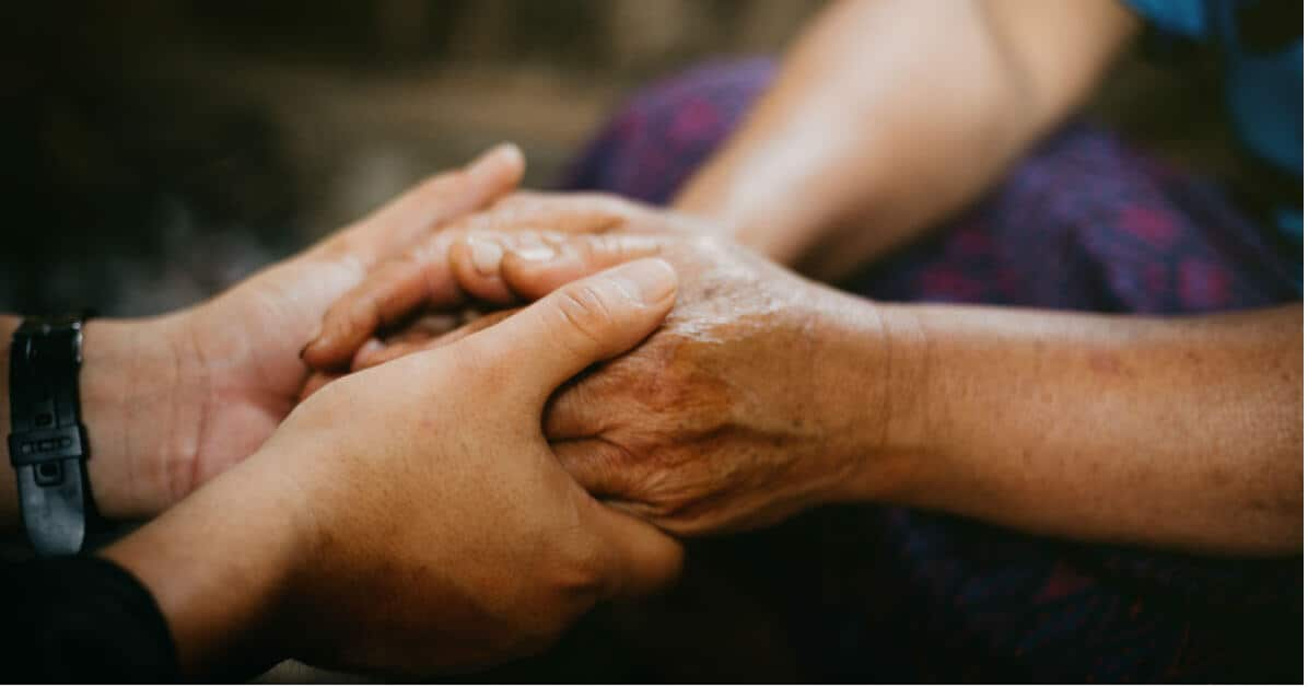 Image of two sets of hands holding each other in prayer. Image credit; lightstock photos
