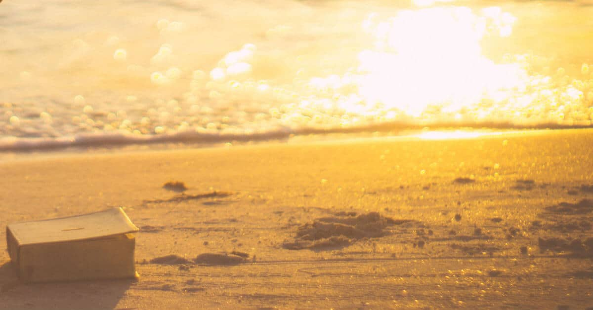 What is my purpose? God will help us to recognize the gifts He has already given us and know our purpose. Image of a Bible on hte sand at the beach at sunset. View of the sand and the water. Image form Lightstock.