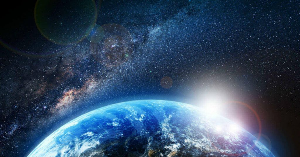 Image of part of the earth and our galaxy form outer space.