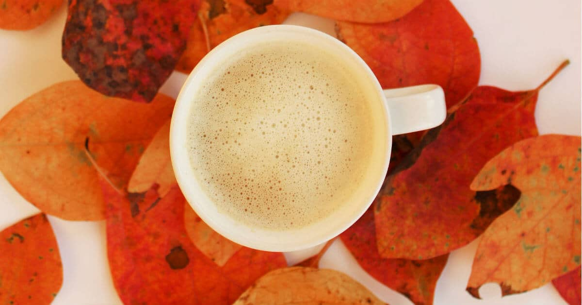 6 easy budgeting tips will help us accomplish financial goals without feeling like a budget is a noose. We want to control our money, not let it control us. Take the time to breathe each month and not stress about money. Image of a cup of coffee on fall leaves. image credit Lightstock images.