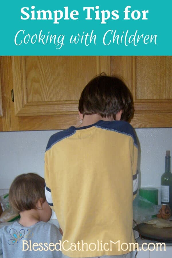Image of two boys side by side at the kitchen counter working to help prepare a family meal.
