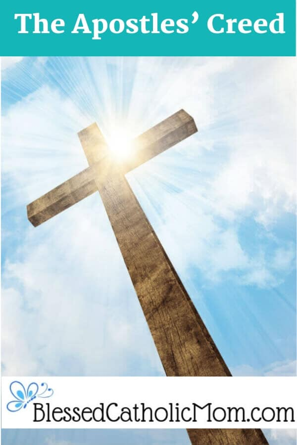As we pray the Apostles' Creed, we identify and profess what we believe about God and our Catholic faith. Image of a cross with the sun shining behind it in a blue sky with some white clouds.