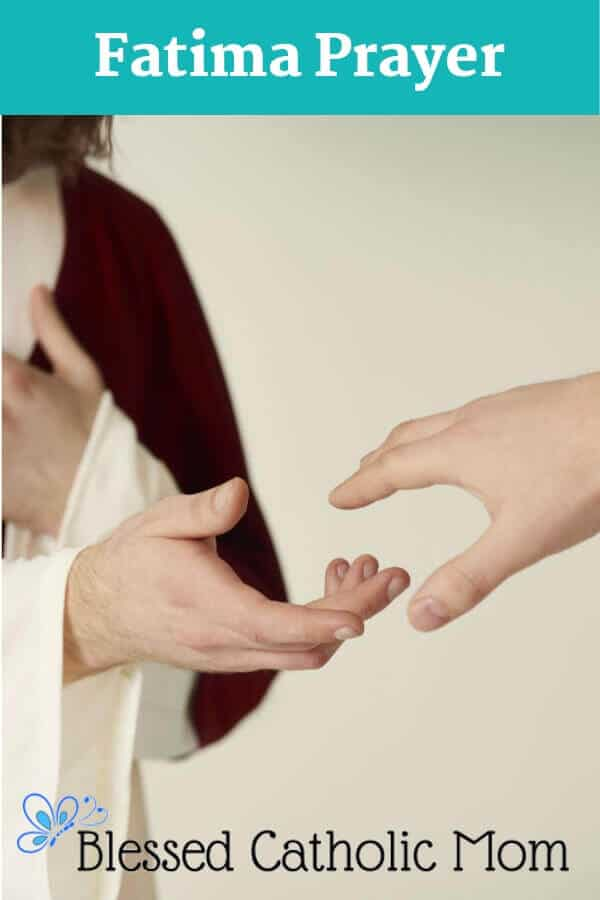 Image of someone dressed as Christ holding out his hand to another person who is reaching back. Only the hands and part of the Christ figure's arms are showing in the image.