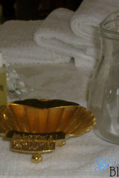 Image of chrism oil, a golden shell, candles, and a water pitcher. #baptism