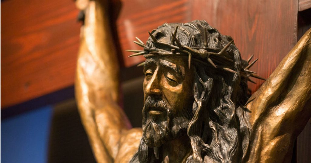 Image of Christ crucified, His eyes partly closed as He hangs on the cross for our salvation.