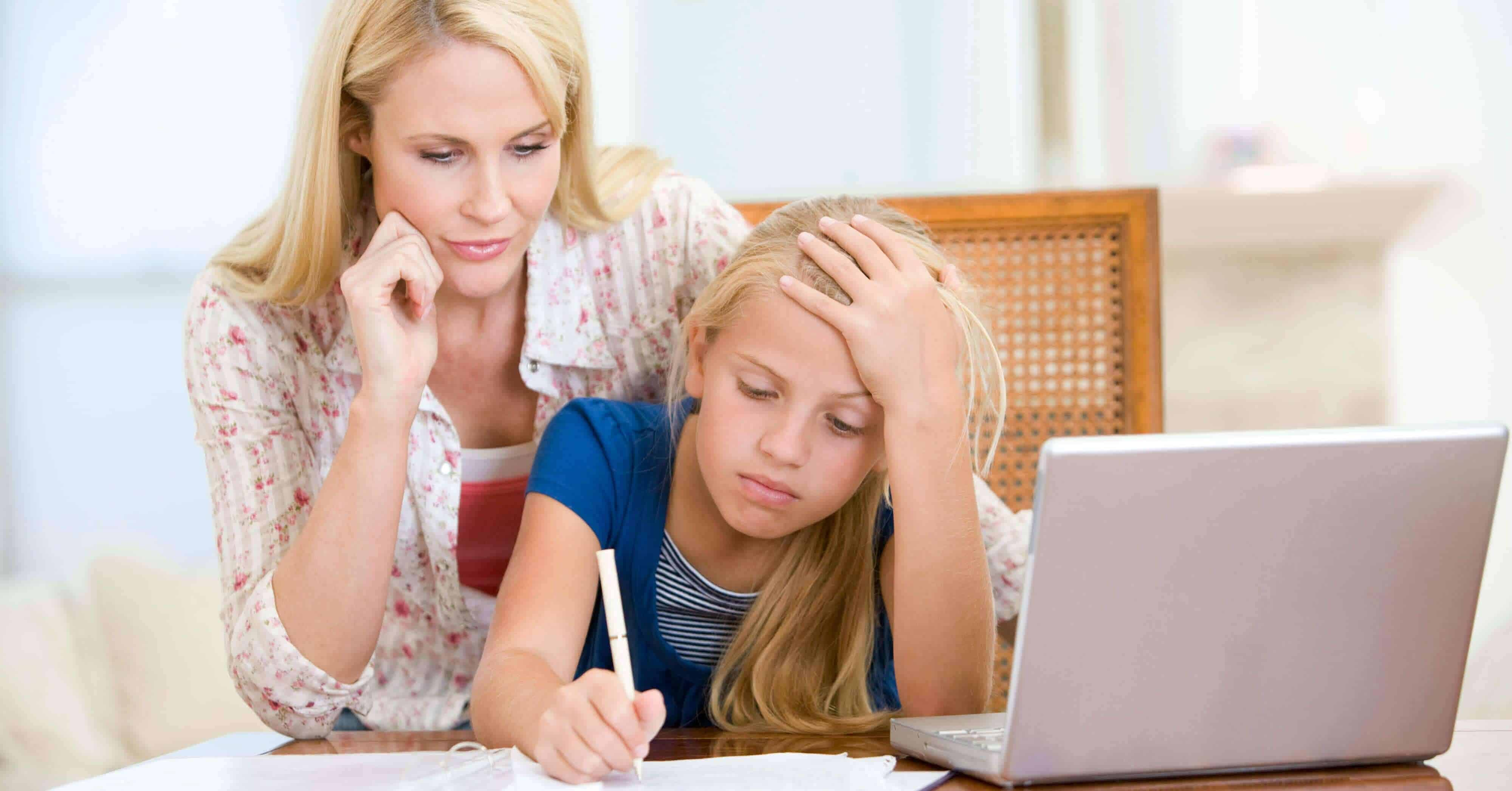 As adults and parents, we need to set the example for our children on how to have a positive attitude. Image of a woman helping a frustrated child with her schoolwork.