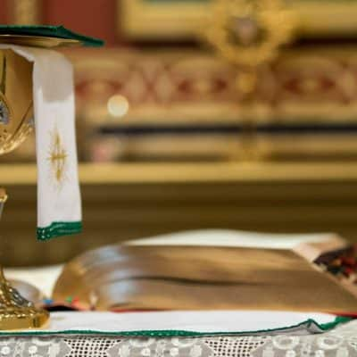Image of a chalice and Roman Missal on the altar.