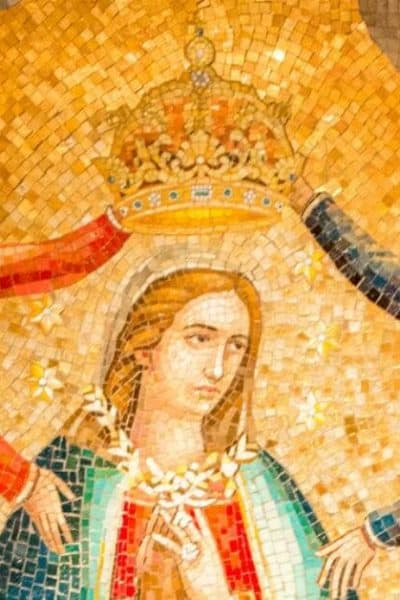 Image of Mary surrounded by angles, some of whom are placing a crown on her head.