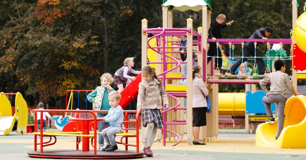 Image of kids playing on a playground.