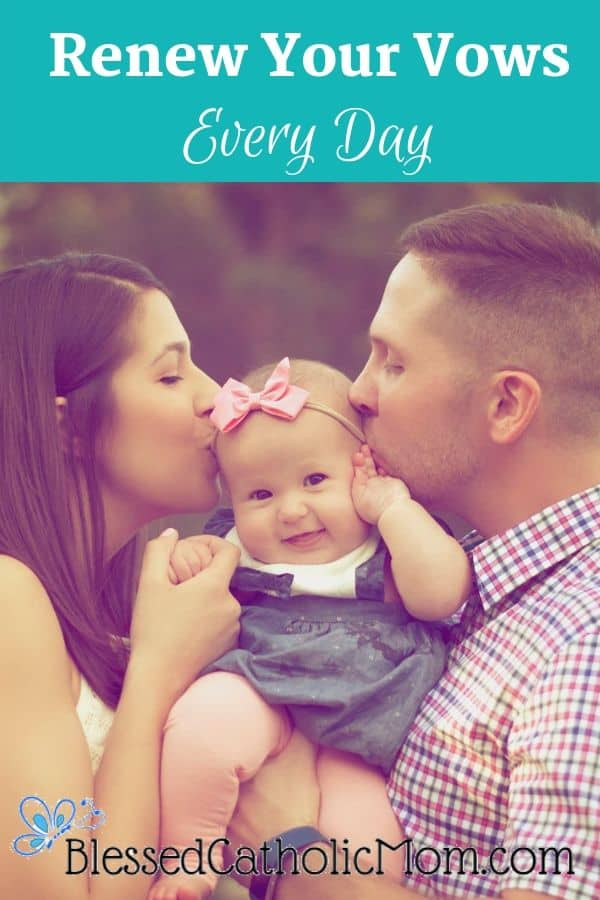 Image of a couple holding a baby between them and each of hem are kissing the baby on the cheek.