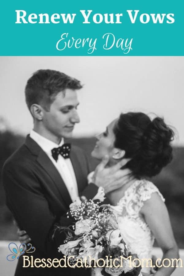 Image of a young just married couple standing together facing each other as they are gazing lovingly into each other's eyes. Photo from Cathopic.