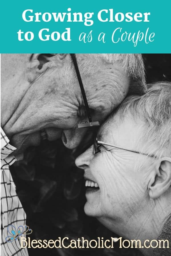 Image of an elderly couple smiling at each other with their foreheads touching.