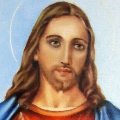Image of Jesus pointing one hand to his sacred heart and holding the other hand up in blessing.
