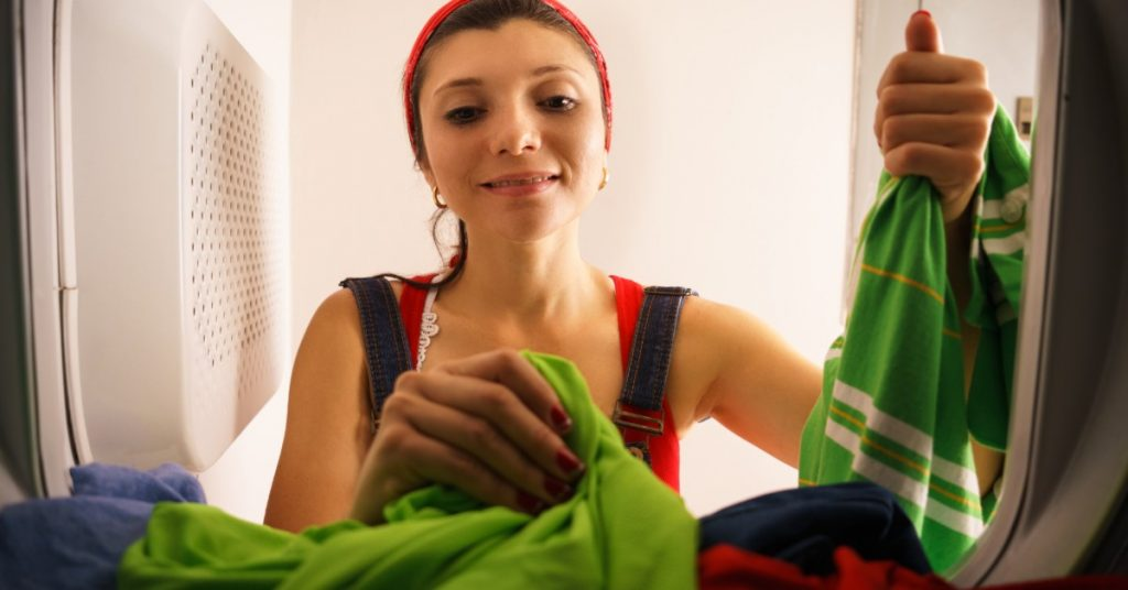 Image of a woman doing laundry.