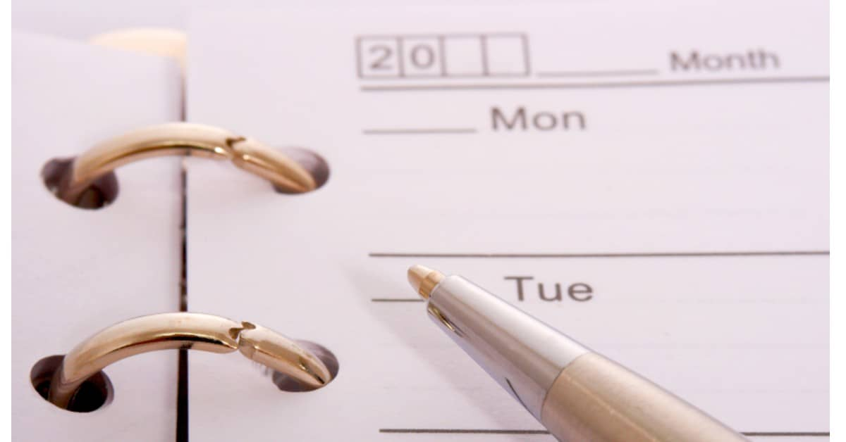 Image of a blank schedule and a pen.