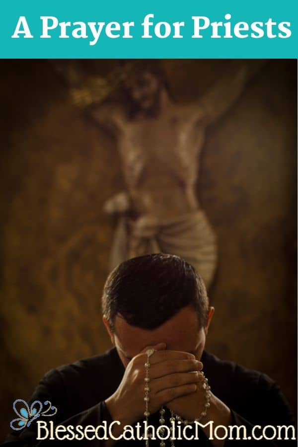 Image of a priest, head in his hands, holding and praying a Rosary. A crucifix is behind him.