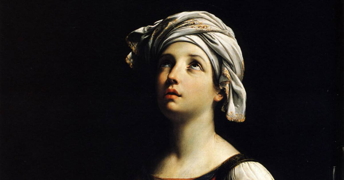 Image of a painting of Saint Cecilia looking up wiht a tranquil look on her face.