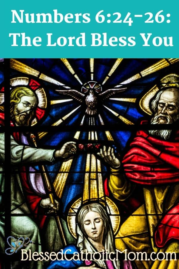 Image of a stained glass window of the Blessed Trinity: Jesus crowned on the left, the Holy Spirit as a dove in the center, and God the Father with His hand raised in blessing on the right side. At the top of the image is the title: Numbers 6:24-26: the Lord Bless You. At the bottom of the image is a butterfly logo and the name Blessed Catholic Mom.