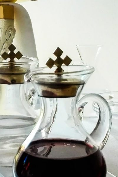 Image of a Chalice and two vessels holing water and wine to be ready for consecration before Holy Communion.