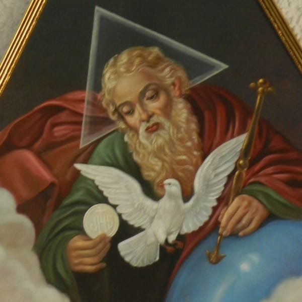 Image of the Blessed Trinity:  God he Father holding the Eucharist (Jesus) with a white dove (the Holy Spirit) in front of them. A triangle is behind the head of God the Father.