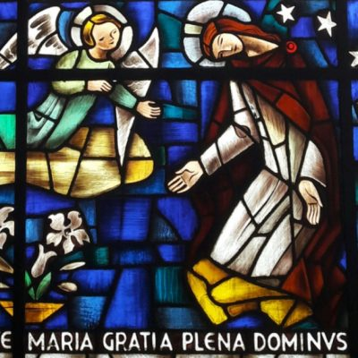 Image of a stained glass window of the Annunciation: the Archangel Gabriel coming to ask Mary to be the Mother of the Christ.