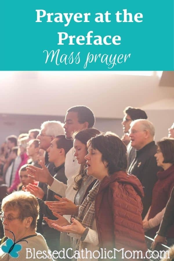 Image of people of different ages and genders standing up during Mass and praying, some with their hands out in praise.  Words above the image read Prayer at the Preface Mass prayer.