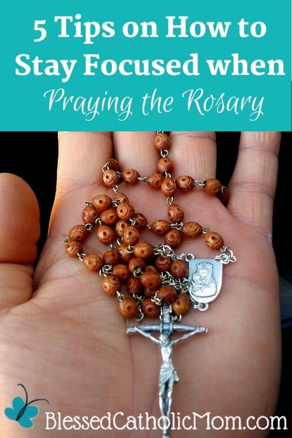 Image of an open hand holding a Rosary. Words at the top of the image read 5 Tips on How to Stay Focused when Praying the Rosary