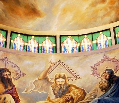 Image of a painting in a church of the Blessed Trinity in Heaven: Jesus, the Holy Spirit, and God the Father.