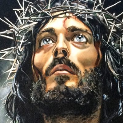 Image of a beaten Christ wearing a crown of thorns looking up to Heaven.