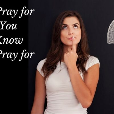 Image of a woman in a white t-shirt with a back blackground standing looking up with a finder over her lips thinking. A white chalk questioinmark isbeside her. To the left of the image are the words: What to Pray for When You Don't Know What to Pray for.