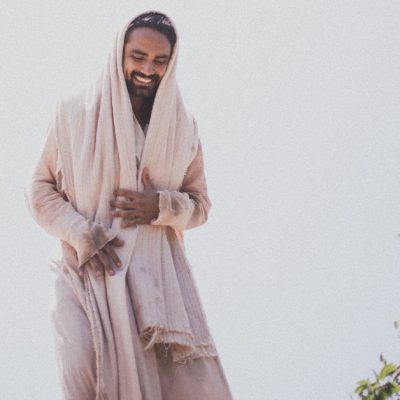 Image of a man as Jesus smiling and walking.
