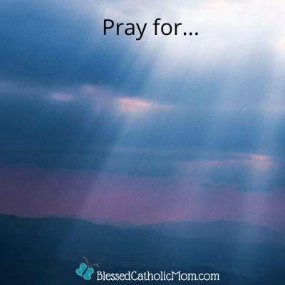 Image of the rays of the sun streaming through the clouds on a cloudy day as the sun is going down. The words Pray for... are at the top of the image and the logo for the website blessed Catholic is at the bottom of the image.
