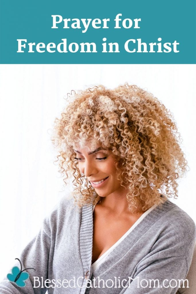 Image of a woman smiling as she is looking down at something. Words above the image read: Prayer for Freedom in Christ. Logo for Blessed Catholic Mom is at the bottom of the image.