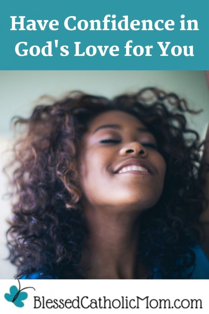 Image of a woman with one arm raised, her eyes closed and her face tilted up with a big smile on her face ans she thinks about God's love for her. Words above the image read Have Confidence in God's Love for You. Logo below the image is Blessed Catholic Mom dot com.