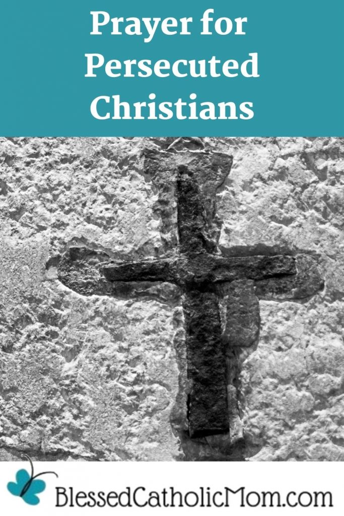 Image in black and white of a concrete wall with a cross etched in the wall that is darker than the wall. Words above the image read Pryer for Persecuted Christians.